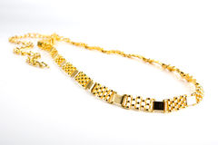 Golden chain. Picture of a golden chain on white background Royalty Free Stock Photography