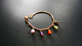 Golden Chain Bracelet with Colorful Beads Stock Image