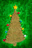 Golden chain Christmas tree on green Stock Photo