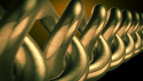 Golden chain closeup. Gold chain moving with depth of field closeup stock video footage