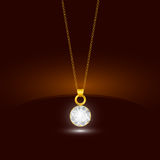 Golden chain necklace with round diamond pendant. Jewelry design. Royalty Free Stock Photo