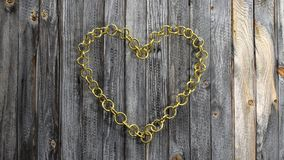 Golden chain in shape of heart Stock Photography