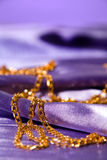 Golden chain on shiny silk Royalty Free Stock Photography