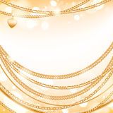 Golden chains on light glow background. Royalty Free Stock Photo