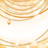 Golden chains on light glow background. Stock Image