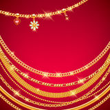 Golden chains on red background. Royalty Free Stock Photography
