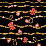 Golden chains and red gemstones with bows pattern. Royalty Free Stock Image