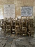 The golden chairs are waiting for the prayers before the mass in the Church of St.Sabina in Rome, Italy. Stock Photo