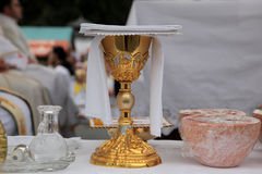 Golden chalice. On the altar stock photo