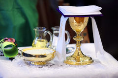 Golden chalice on the altar during the mass.  royalty free stock photos