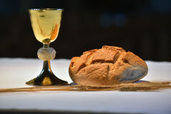 Golden chalice, bread. Royalty Free Stock Photos