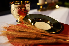 Golden chalice, paten and Roman misal. Royalty Free Stock Photography