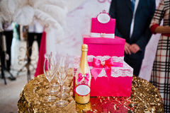 Golden champagne bottle with glasses Stock Images