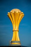 Golden championship trophy on a blue background Royalty Free Stock Photography