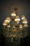 Golden Chandelier. Luxury golden colored brass chandelier light fixture Royalty Free Stock Photography