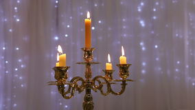 Golden chandelier with candles stock footage