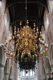 A golden chandelier inside a church Royalty Free Stock Photos