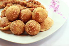 Golden cheese balls fried. Covered with sesame on a plate Stock Photo