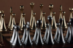 Golden chess figures. The photo shows the chessboard with metal figures Royalty Free Stock Image