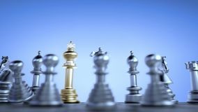 The golden chess king in the rear of the enemy smashes silver pawns stock video footage