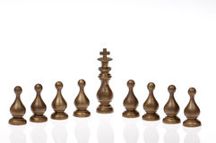 Golden chess pawns and King Royalty Free Stock Photo
