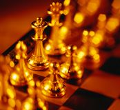 Golden chess pieces Stock Photo