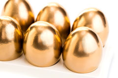 Golden chicken eggs closeup Stock Photo