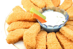 Golden chicken fingers and veggies Stock Images