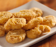 Golden chicken nuggets closeup Royalty Free Stock Photography