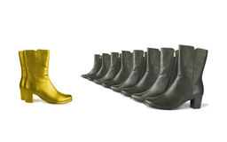 Golden (chief) and black (team) boots royalty free stock images