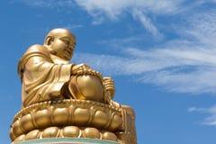 Golden Chinese buddha on blue sky background Royalty Free Stock Image