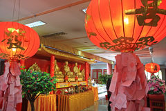 Golden Chinese Buddha statues and lanterns Stock Photos