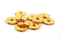 Golden chinese coin. Ancient chinese gold coin replicas Stock Images