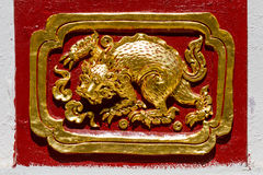 Golden Chinese creature low relief Royalty Free Stock Photos
