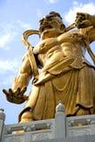 Golden Chinese deity statue Stock Image