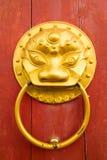 Golden Chinese door knocker Royalty Free Stock Image