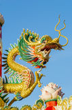 Golden Chinese Dragon Wrapped around red pole Royalty Free Stock Photos