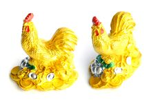 Chinese good luck rooster on white background. Golden Chinese good luck rooster statue isolated on white background royalty free stock photos
