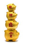 Golden chinese piggy banks. Isolated over white space Stock Photos
