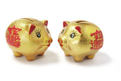 Golden Chinese Piggy Banks Royalty Free Stock Photography