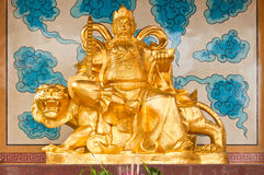 Golden Chinese Prosperity Money God. Sit on a tiger stock photography
