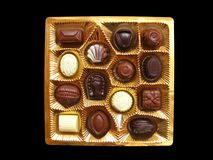 Golden chocolate box Stock Photos