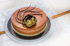 Golden chocolate cake with flower and pearls Royalty Free Stock Images