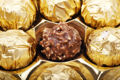Golden chocolate close-up Stock Photos