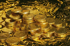 Golden chocolate coins Stock Photography