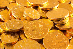 Golden chocolate coins Stock Images