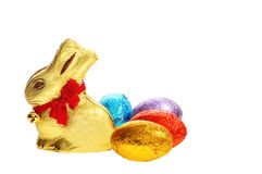 Golden chocolate Easter bunny with eggs royalty free stock image