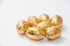 Golden chocolate easter egg on the white background Stock Photo