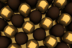 Golden and chocolate eggs Stock Images