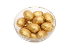 Golden chocolate eggs Stock Image